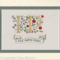 Two initials in 24c gold leaf with thistles, roses and musical notes