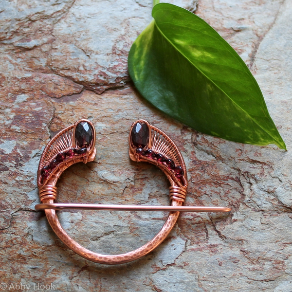 Penannular Brooch - Copper and Garnet