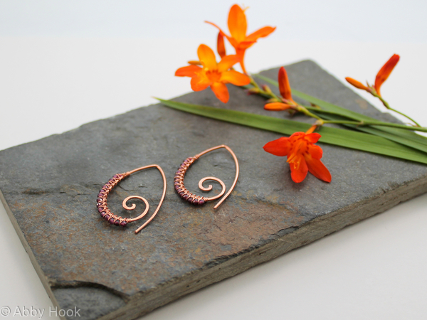 Embellished Ammonite open pointed spiral tribal earrings - 1mm copper and faceted Garnet