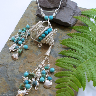 The Water Carrier tassel pendant