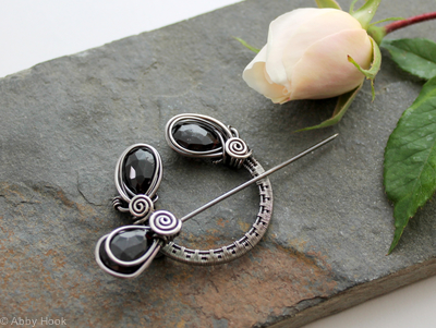 Penannular Brooch - Woven Sterling silver and faceted Garnet