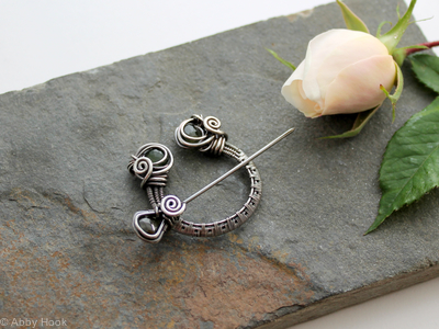 Penannular Brooch - Woven Sterling silver and faceted Green Tourmaline