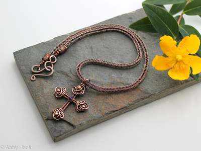 St Lucia - Ornate Wire Cross with faceted Amethyst and woven copper wire on a Viking knit chain