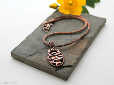 Akurra - Entwined snake pendant in copper wire on a Viking knit chain