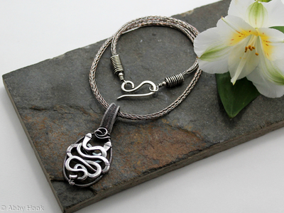 Akurra - Entwined snake pendant in sterling silver wire on a Viking knit chain