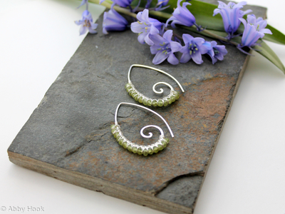 Embellished Ammonite open pointed spiral tribal earrings - 1mm sterling silver and faceted Peridot