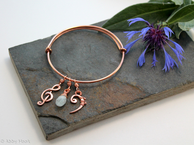 Adjustable bracelet with musical and birth stone charms