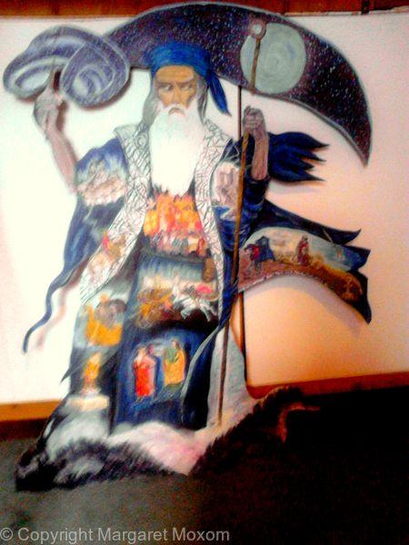 Merlin - with scenes from Arthurian legend painted in Merlin's cloak