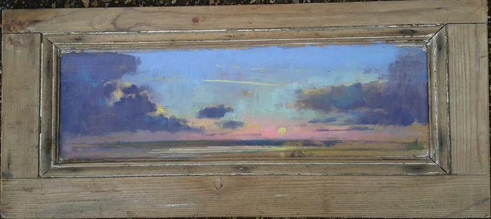 Pink sky on wooden door