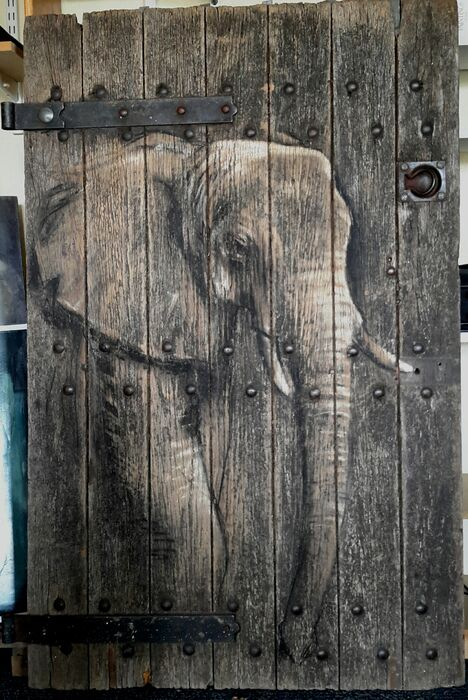 Elephant painted on pub cellar door (heat as an elephant )