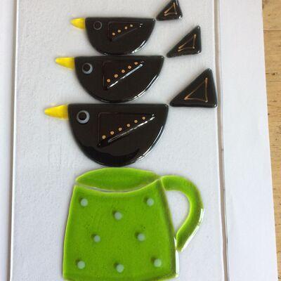 Trio of blackbirds on cup