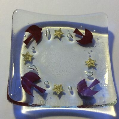 small dish with birds and stars