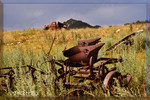 Vintage farm implement and flatbed on the hill