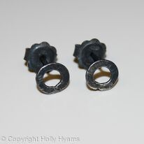 black little circular studs