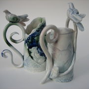 2 small porcelain vessels with perching birds