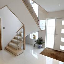Contemporary Stair made from maple and glass with stainless steel fittings