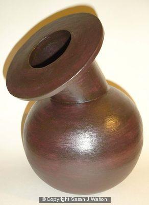 Black stoneware bottle with angled neck