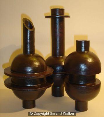 Group of black stoneware bottles