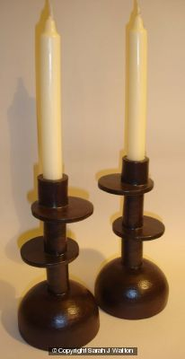 Black stoneware candlesticks with offset discs