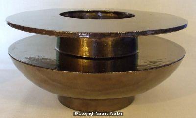 Low wide rim vessel