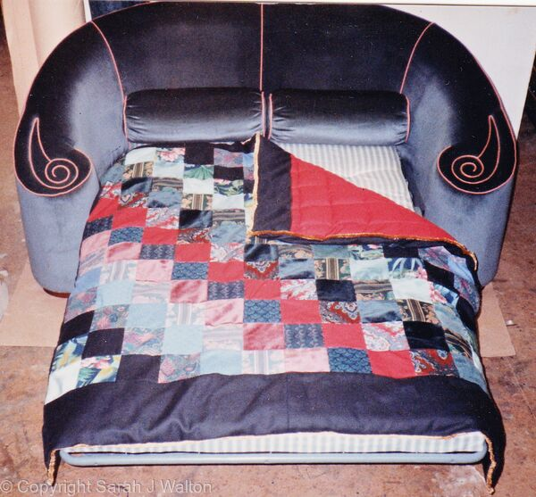 Sofa-bed with reversible quilt