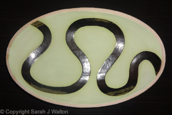 Pale green 'river' dish