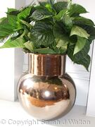 Gold globe pot.