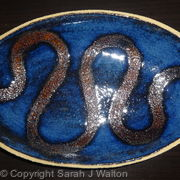 Fully glazed blue 'snake' dish