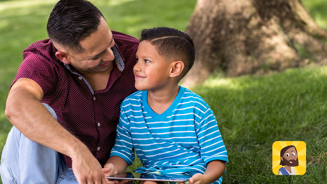 Father and son usin Bible App for Kids