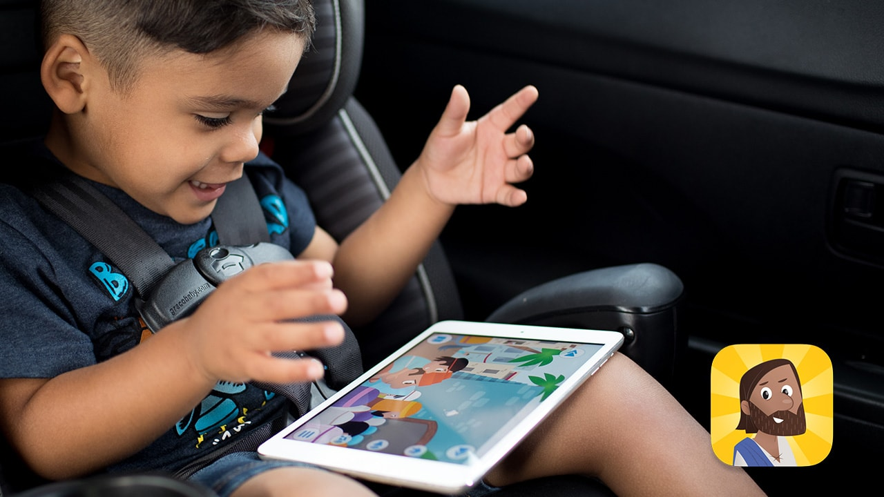 Kid playing Bible App for Kids on tablet in the car