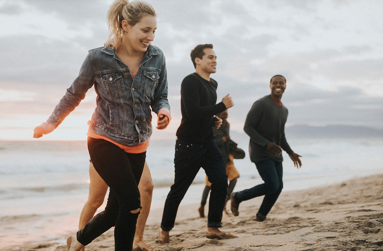 People running on a beach