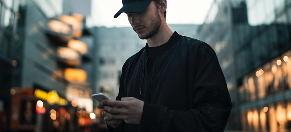 Man looking at phone in city