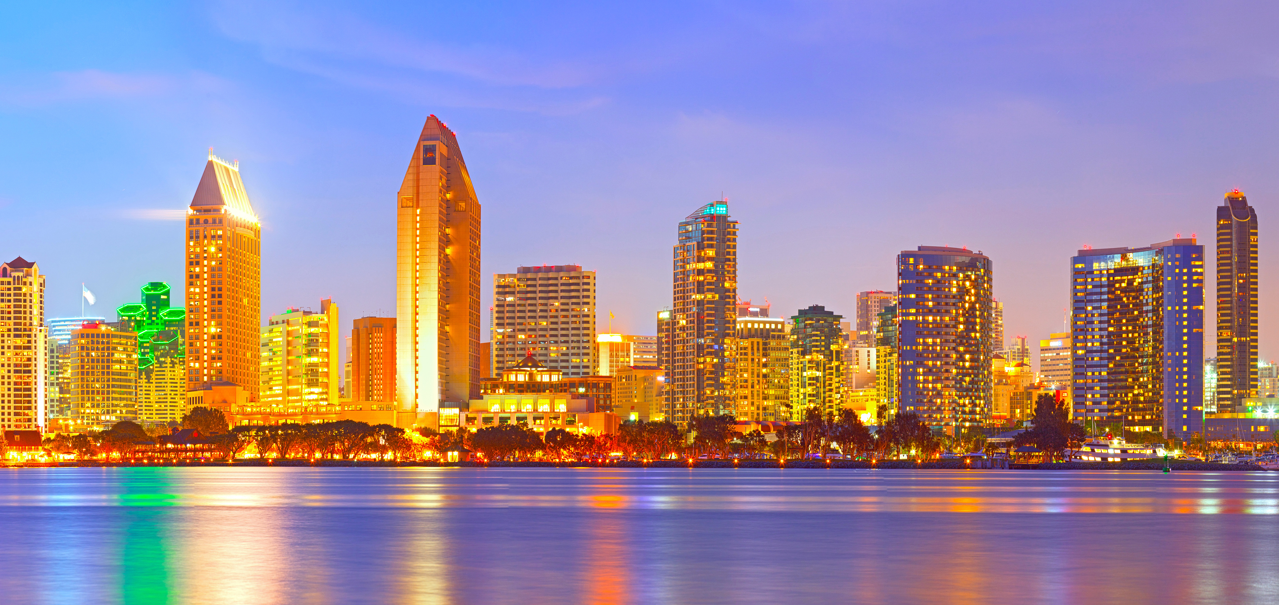 San Diego California, city skyline at sunset on a beautiful summer night with lighted skyscrapers and downtown buildings