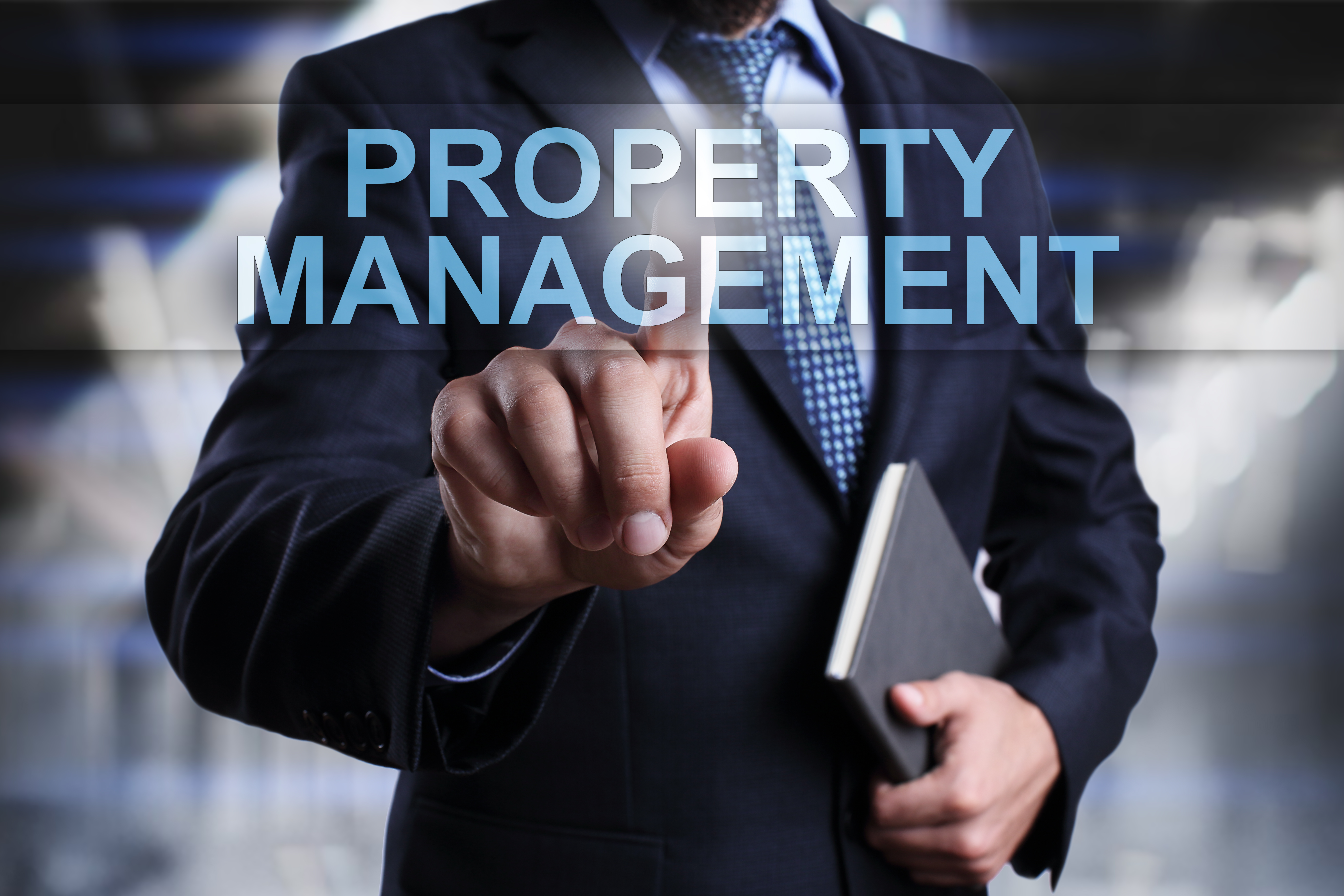 Businessman is pressing button on virtual screen and selecting Property Management.