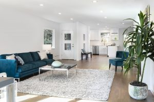 Beautiful and large living room interior with hardwood floors,  fluffy rug and designer furniture.