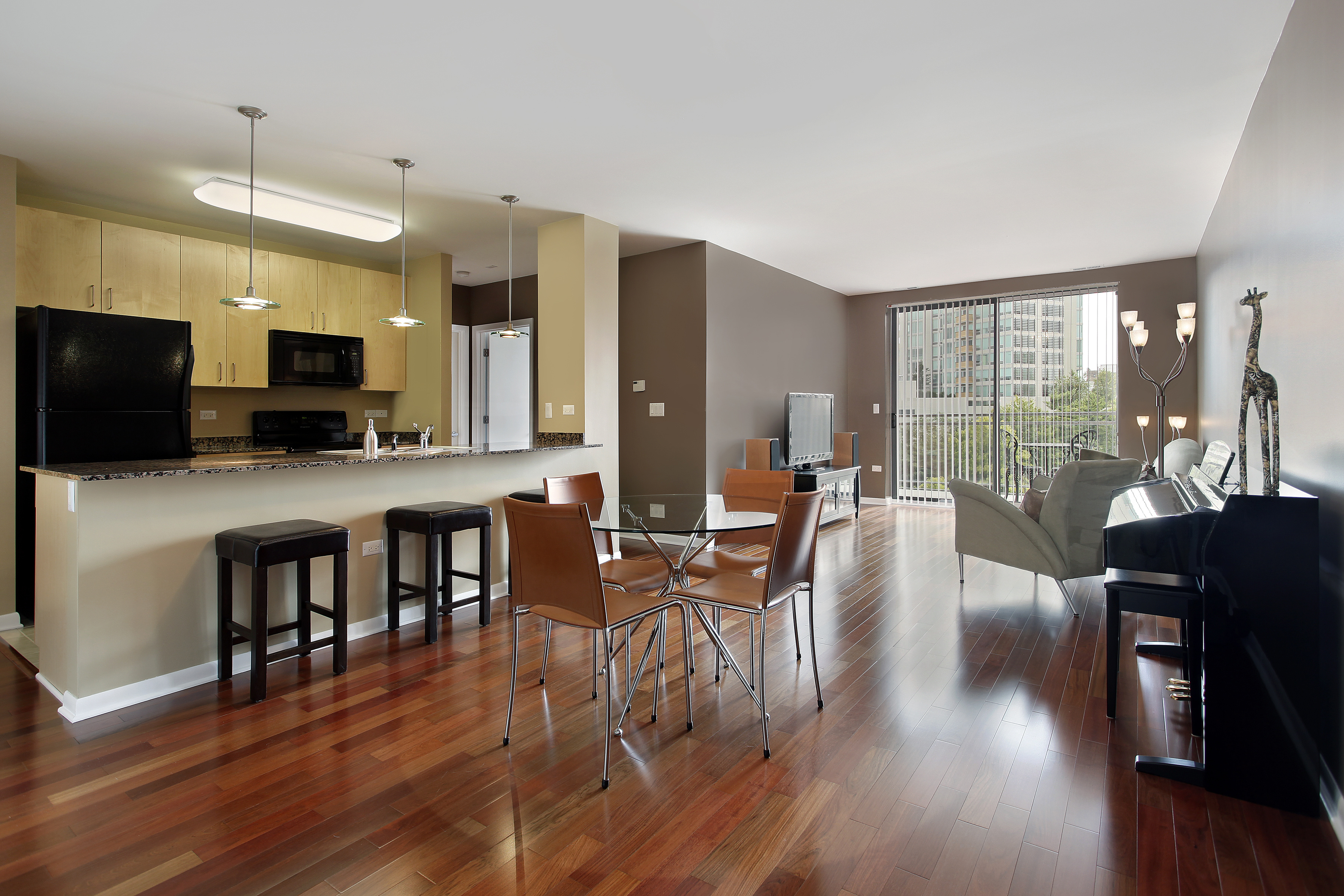 Condo with open floor plan and granite kitchen counter top