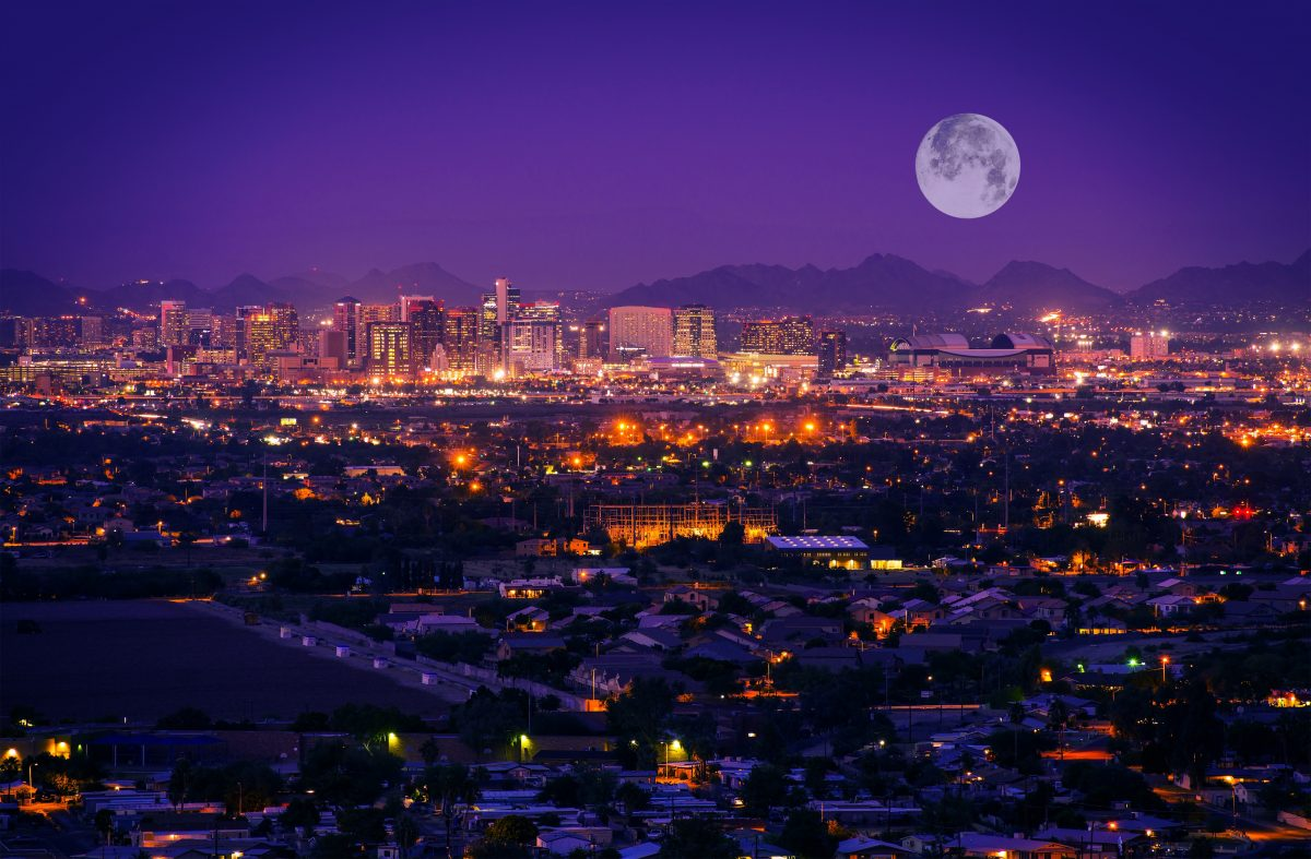 Phoenix Arizona Skyline at Night. Full Moon Over Phoenix, Arizona, United States.