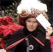 Johnny Carson as Carnac the Magnificent
