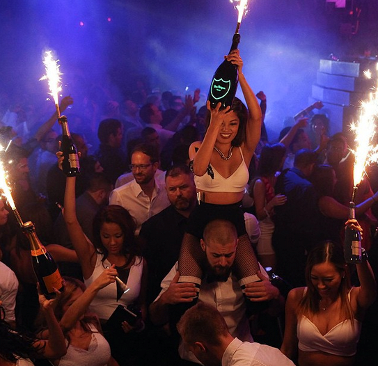 girl with large champagne bottle vegas