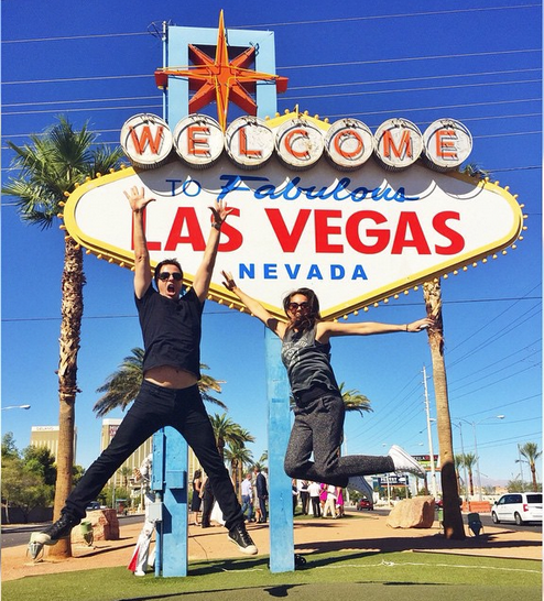 couple at the welcome to las vegas sign