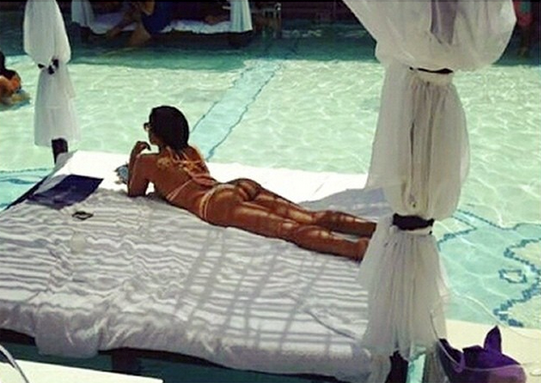 girl laying in vegas daybed by the pool