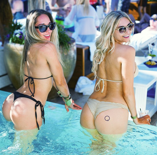 marquee logo stamp on biki clad girl at dayclub pool