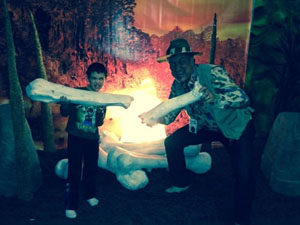 Pose with dino sized bones in front of our prehistoric bonfire.