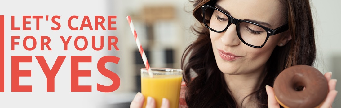 A girl with glasses holding a smoothie and a donut