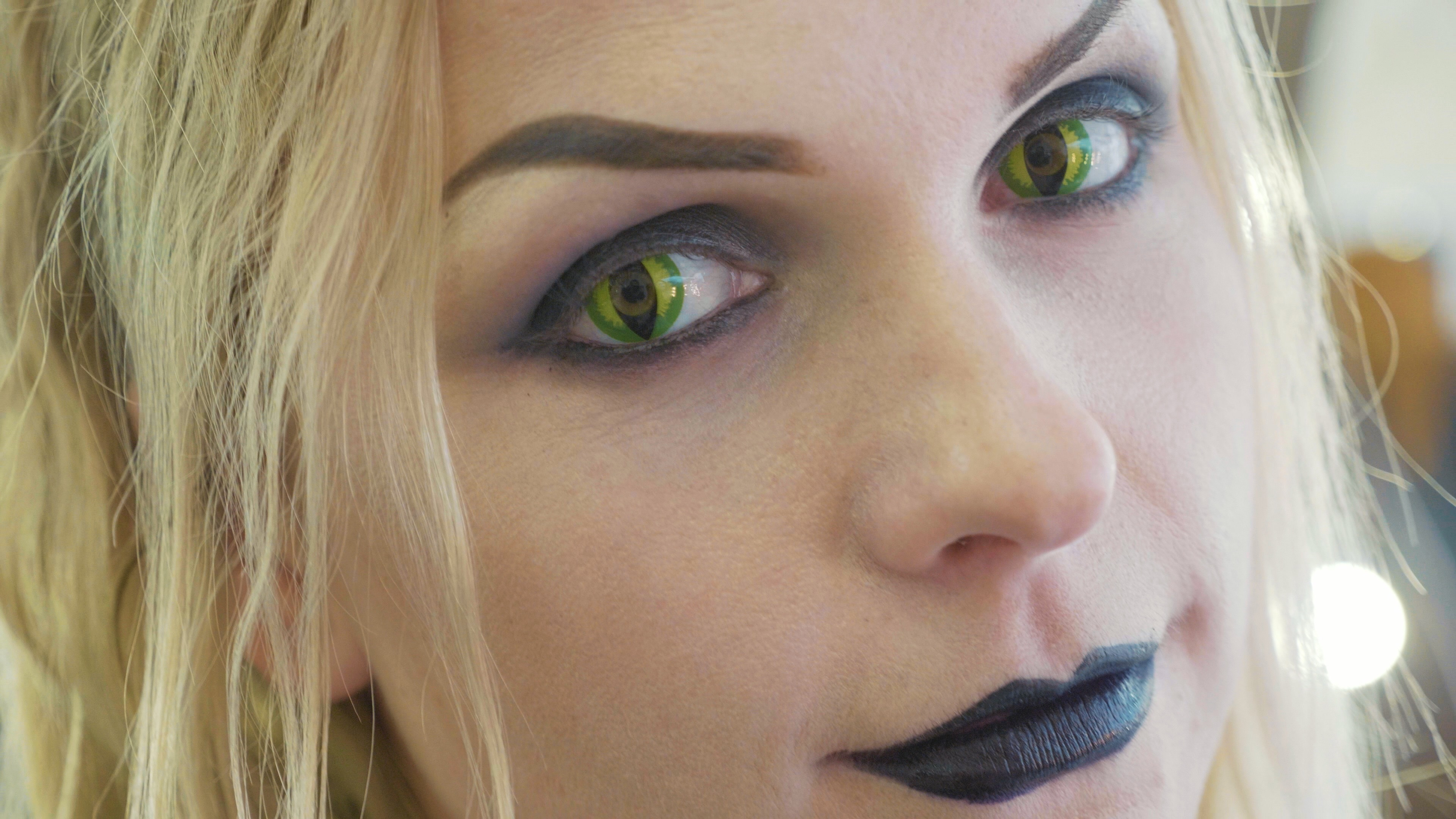 Girl in Cat Eye Halloween lenses