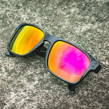 mirrored sunglasses with orange & pink reflection