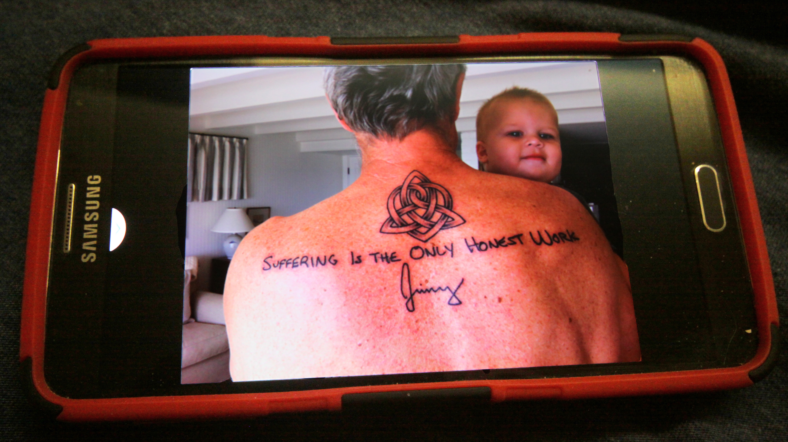Casey tattoo on phone
