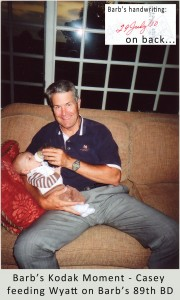 Casey holding his three month old grandson, Wyatt, feeding him his bottle