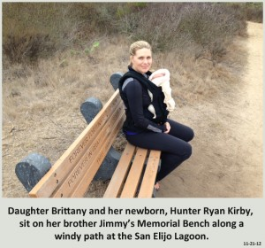 Daughter Brittany and her newborn, Hunter Ryan Kirby,  sit on her brother Jimmy's Memorial Bench along a windy path at the San Elijo Lagoon.
