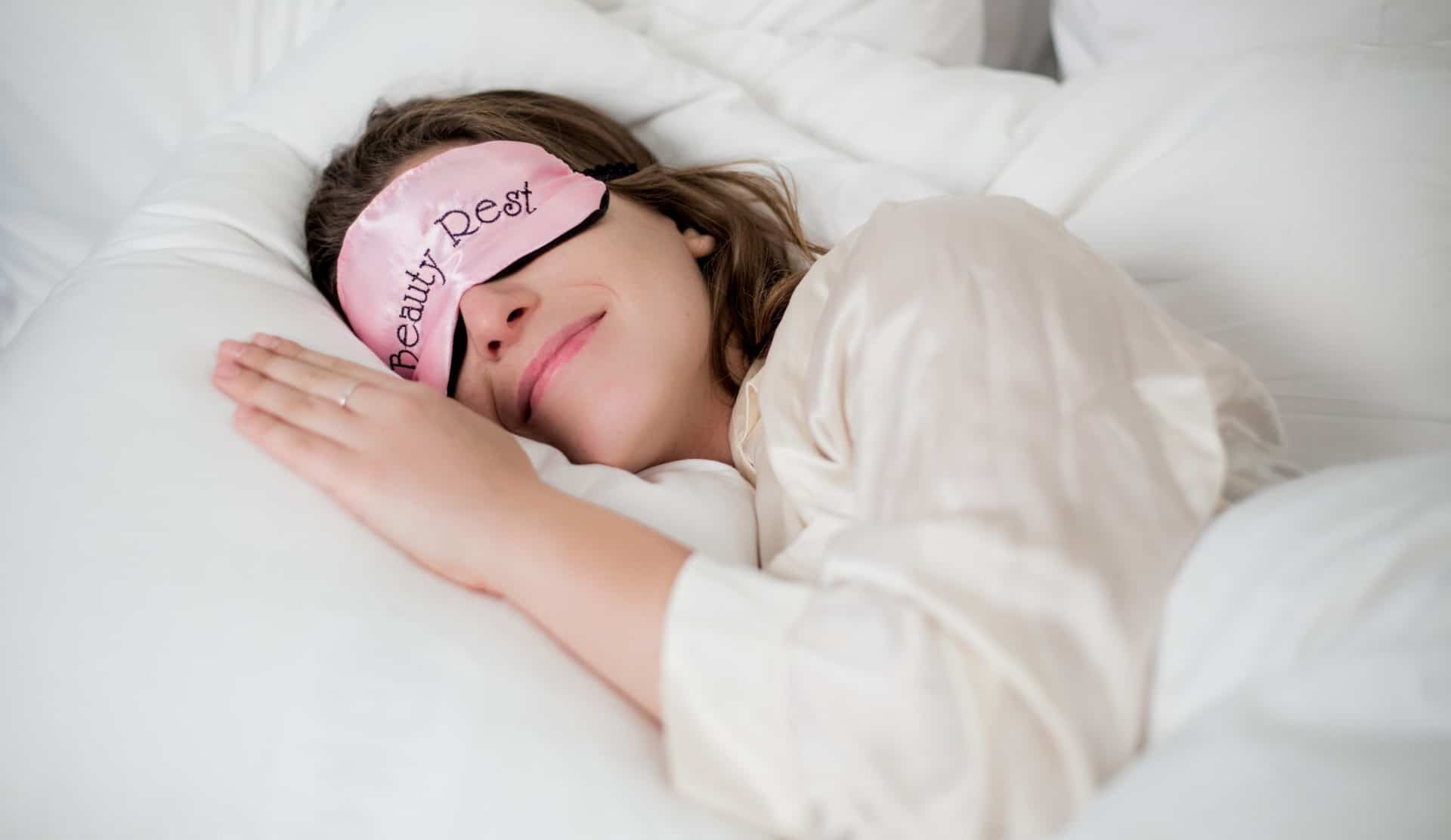 Woman sleeping with sleep mask
